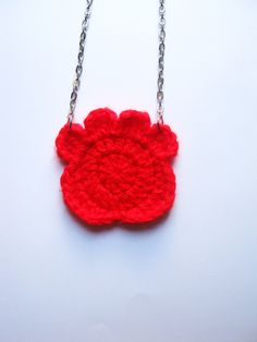 Crocheted animal paw necklace.