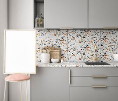 This terrazzo countertop and backsplash really brighten up the grey cabinet and add a feminine touch to the whole design Peel And Stick Tile, Stick On Tiles, Kitchen Backsplash, Kitchen Cabinets, Grey Cabinets, Kitchen Dining, Kitchen Decor, Terrazzo Flooring, Cuisines Design