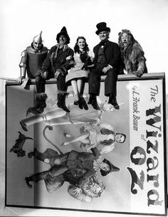 Dorothy, the Tin Man, the Scarecrow, the Cowardly Lion, and the Professor in a publicity photo for The Wizard of Oz.