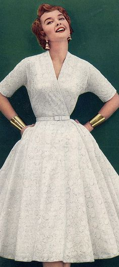 1950s Fashion - sporting the Wonder Woman cuffs decades before! vintage style 50s dress full skirt white lace day or party