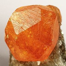 Spessartine crystal on muscovite matrix from Tanzania