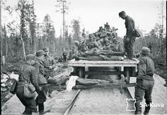 Finnish soldiers loading their dead.