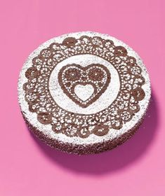 use a paper doily to stencil on your valentine's day goodies