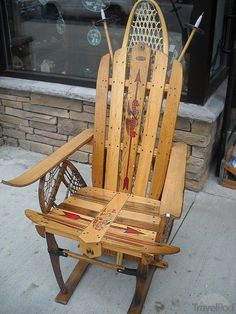 Chair made from vintage snow sleds, snow shoes and ski poles.