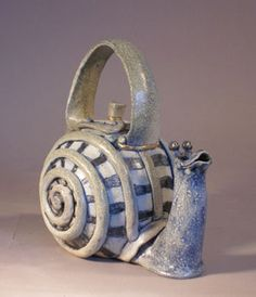 Tim Storey - snail teapot. Hopefully the tea inside will take just the same amount of time to lose it's warmth as the snail would to make it across the table. #cute #china