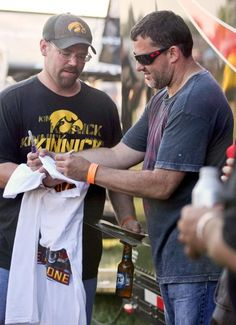 Tony Stewart, right, autographs a shirt for Jeremy Hayes of Montezuma, Iowa, at Southern Iowa Speedway in Oskaloosa, Iowa. Stewart will miss this weekend's road course race at Watkins Glen after breaking his right leg in a sprint car race Monday night at Southern Iowa Speedway. (Mary Willie/The Des Moines Register/AP)