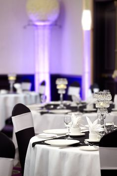 Take inspiration from this beautiful black and white wedding decor with coloured up-lighting
