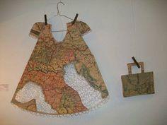 Diseños y ropa de todo el mundo ; ropa de andar por el mundo, un ropero de viajes y el mundo en un vestido.