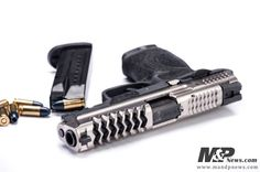 Custom M&P pistol from MandPnews.com Find our speedloader now!  http://www.amazon.com/shops/raeind