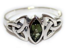 Ring Specifications: Design: Triquetra, Celtic Triple Knot Dimensions: 4 x 8 mm Marquise Metal: .925 Sterling Silver Sizes: 4 - 12 This stunning Sterling Silver ring features a faceted Moldavite marqu