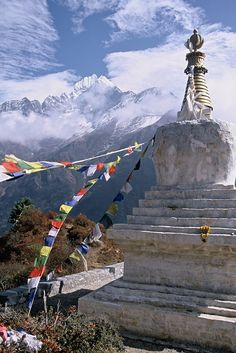 Tenzing Chorten, Everest Trail I loved the cloud formations and the site of the brightly coloured prayer flags adorning the Chorten was a welcome bit of colour in a landscape that was rapidly changing from lush lowland valley to high Himalayan pass.  #rock #climbing #mountaineering #cliff