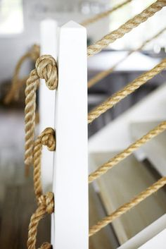 Coastal interior -- staircase railings made from rope  |  Photos by Stacey Van Berkel