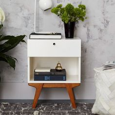 Inspired by Scandinavian modernism, our Modern Bedside Table marries a simple silhouette and minimal hardware with playfully angled legs in a warm pecan finish. The result? Storage that's easy on the eyes and fits in with an eclectic mix of furniture.