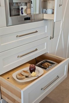 To save space, a toaster is tucked into a drawer beside the breadbox.