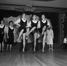 Chorus girls at Forbidden City show off their stuff.  San Francisco circa 1950.