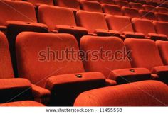 Photo about Rows of numbered theatre seats. Image of auditorium, seating, forum - 4873566
