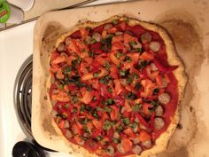 Paleo pizza from Everyday Paleo. Crust: 2 cups almond meal, 2 eggs, 3 T EVOO, 1/4 tsp baking soda, 1 tsp garlic powder, 1 1/2 T fresh rosemary. Toppings: 1 lb Italian pork sausage, 2 crookneck yellow squash (didnt use), 3 green onions, 1 c basil leaves, 2 small tomatoes, 1/2 c roasted red peppers, 1/2 c sliced black olives, 1c organic gluten free marinara sauce. Preheat oven to 350. Bake crust 20 mns then add other ingredients and bake 25-30