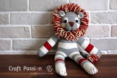 Make your own sock monkey by using this ultimate pattern and tutorial. Easy to…