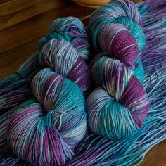 Midnight Mermaid - Deep tones of teal blue and purple come together into a blend of colors that would make any mermaid happy to wear at night. ~~~~~ Hand Dyed Merino Sock Yarn 80% superwash merino wool for softness / 20% polyamide for durability • Each 100g (3.5 oz) skein has