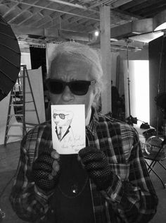 """""""A while back, I sent Karl a drawing as a way to say thank you. I found out he carries it in his journal with him!  To me this is truly surreal... and it encourages me to start drawing again. Here is Mr. Lagerfeld himself with my Karl Lagerfeld bear drawing."""" Go Soojoo!"""