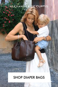 The Sophia looks like a chic leather handbag but acts like a practical diaper bag so you can carry around all your baby stuff while still looking stylish. Many of my customers continue to use their Sophia even after the baby years because it's such a functional bag. Join our tribe today and get 10% off your first order at alexandradecurtis.com/join