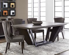 LANGLEY DINING TABLE | This dining table combines rustic with modern architectural elements, featuring a substantial concrete top with tapered edges and a tapered solid acacia wood base in a coffee bean finish.