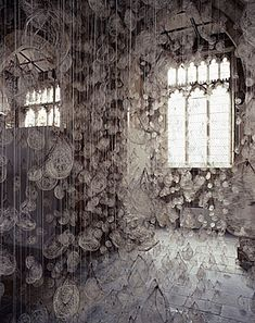 """Susie MacMurray, """"Echo"""". 2006. Site specific installation, York St Mary's. 10,000 hairnets containing strands of used violin bow-hair. www.susiemacmurray.co.uk"""