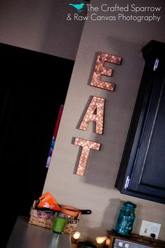 Pennies on wood block letters