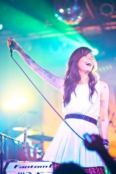 Christina Perri love her and her tattoos. I like how she doesn't have to get a huge tattoo to look big and bad.. she gets the little ones that matter most