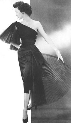 Suzy Parker in a Lanvin-Castillo cocktail dress, photographed by Georges Dambier for ELLE, 1952.