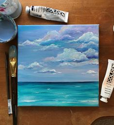 Original Acrylic Painting Titled Clarity A coastal painting of fluffy clouds on a beautiful beach day. Mostly blues and whites with subtle hints of pinks, purples and gold. I use high quality acrylic paints on artist grade canvas. This painting has been sealed with acrylic varnish
