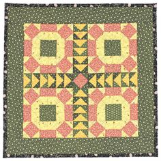 This miniature quilt showcases antique 1880s fabrics in traditional Pennsylvania German colors of chrome yellow, double pink, and over-dyed green.