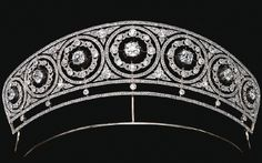 Diamond tiara, ca. 1905          Designed as a series of seven graduated circles millegrain-set with rose stones, each inset with a rose and circular-cut diamond wreath, to a cushion-shaped diamond center set in cut-down collets, further decorated by foliate motifs similarly-set,     the detachable circular elements can be worn as brooches, fittings deficient; the cushion-shaped diamond collets unscrew and fit a necklace front mount.