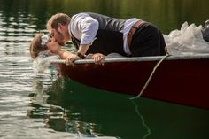 Bride and Groom taking wedding photos on the lake in a little rowboat - SO cute. We loved capturing this mountain wedding photography up in Barriere, British Columbia Canada!  http://tailoredfitphotography.com/wedding-photography/kamloops-barriere-wedding-johnson-lake-resort/