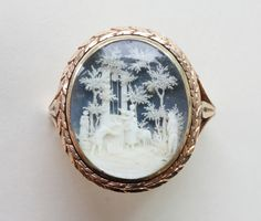 An 18 carat gold ring with an extremely fine microscultpure in ivory, Vienna, circa 1775. Maker or Designer: Sebastian or Paul Hess