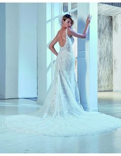 Beautiful lace low-back dress available at Spotlight Formal Wear! #SpotlightBridal