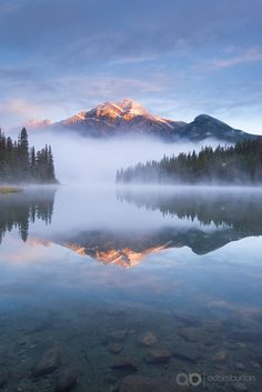 Perfect Pyramids - Pyramid Mountain in the Canadian Rockies surrounded by mist and reflected in Pyramid Lake, Jasper National Park, Alberta, Canada. Autumn (September) 2015.