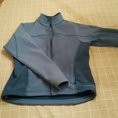 L.L. Bean jacket Size medium, shell jacket with pockets. Moisture wicking fabric. In good condition, some discoloration on sleeves, might come off in wash (I will check). Offers welcome! L.L. Bean Jackets & Coats