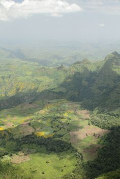 view of farmland and village below - Amhara, Ethiopia