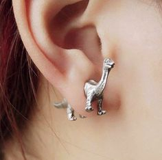 BACKORDERED: WE ARE RESTOCKING THIS ITEM, EXPECT AT LEAST 4 WEEKS FOR THIS TO ARRIVE 50% off - today only! These cute, silver plated dinosaur earrings are one of our best-sellers. Get a pair now while they're 50% off.  Silver Plated Type: Stud
