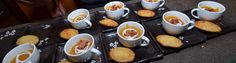 Roasted butternut squash with bacon with swirl of Greek yogurt thinned with cream. Served with Parmesan Rosemary madeleines.