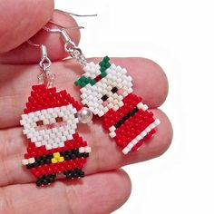 Cute pair of Santa and Mrs. Claus earrings. Both Santa Claus and Mrs. Claus are hand beaded with Miyuki Delica seed beads in the brick stitch bead