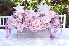 Tic-Tock Couture Florals created the beautiful pink and purple arrangements, which also incorporated star-shaped magic wands and ribbons. Source: Melody Melikian Photography