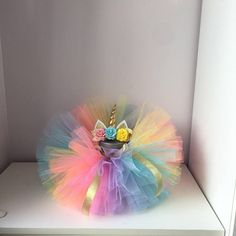 This set consists of a headband and tutu skirt. The tutu is made of tulle pink aqua labender ana yellow colours. The set will be perfectly suited for the summer birthday, childrens parties and also for photo-shooting Avialable seizes from 0 month up to 3years. If you want to buy