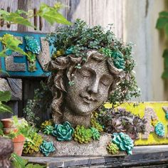 For a different take on the fairy feel, this stone sculpture planter is ideal.