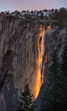 Sunlit appears to set Horsetail Falls aflame,Yosemite National Park