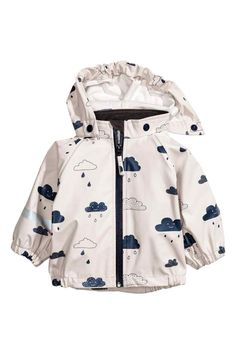 Jacket in patterned, wind- and waterproof functional fabric with welded seams and a detachable hood that is elasticated at the front. Waterproof zip down th H&m Fashion, Baby Girl Fashion, Toddler Fashion, Fashion Kids, Baby Outfits, Baby Kids Clothes, Neutral Baby Clothes, Kids Wear, Rain Jacket