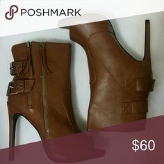 Booties Peep toe booties. Camel color. Never worn. Longer zipper unzips for easy on. Shorter zipper is just for show. Buckles do adjust buy shouldn't affect the fit. Appx 4 inches. Shoes Ankle Boots & Booties
