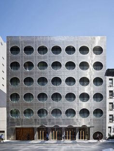 Architecture, Unique Prefabricated Dream Downtown Hotel Construction In Circle Perforated Wall Building In Grey And Wooden Combination At Ground ~ Amazing Hotel Building with Metal Panels