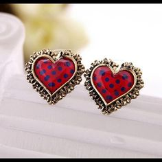 Betsy Johnson heart shaped gold laced earrings. Betsy Johnson heart shaped gold embossed earrings.  Red with blue accents is eye catching. Betsey Johnson Jewelry Earrings